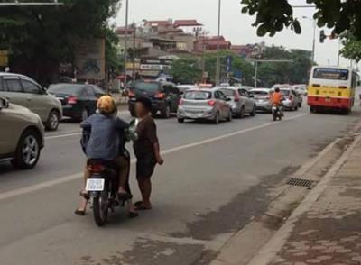 Cảnh báo cướp tiền bằng xi lanh có HIV trên đường Phạm Văn Đồng